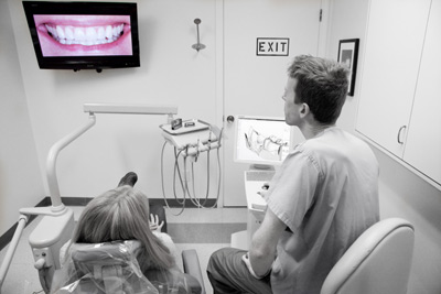 Hawthorne Dentist Keith Watson speaking with dental patient