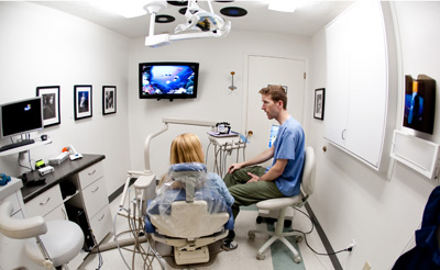 Dentist confering with patient